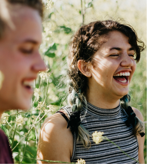 Two individuals laughing