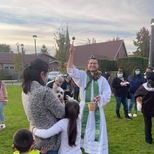 Fr. Carlos blesses dogs, cats, birds, hamsters, rabbits and more!