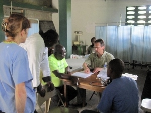 Lori Henke, Vicar Duprey and Dr.Mark with our interpreters in the clinic