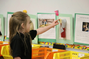 Kindergarten students learn holiness through saint presentations