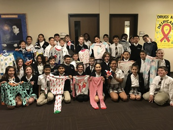 Pajamas, Reading, Service Come Together in Pajama Program