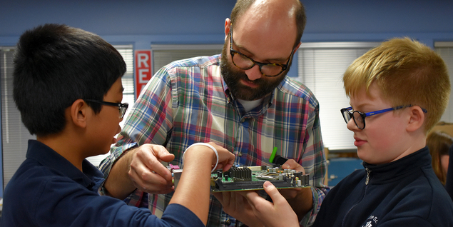 middle school students in makerspace with media teacher