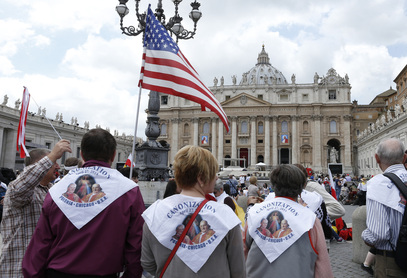 Pope Francis, with retired pope, canonizes Sts. John and John Paul