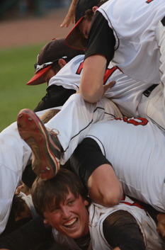 Dog Pile, Catholic Style... Davenport Assumption Catholic players celebrate their state title, Saturday August 2 at Des Moines