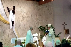 Bishop Murry installs Fr. Ed Stafford as pastor