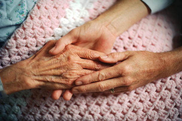 hands of caregiver