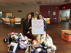 Thank you for your donations! The PYC collected 404 pairs of socks!