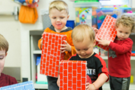 Toddlers playing with play bricks