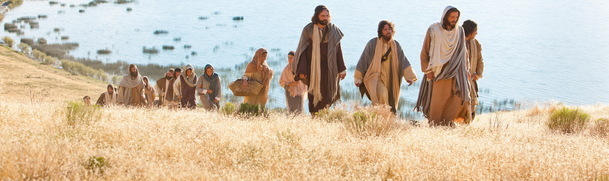 This is an image that depicts Jesus walking, presumably, with his apostles