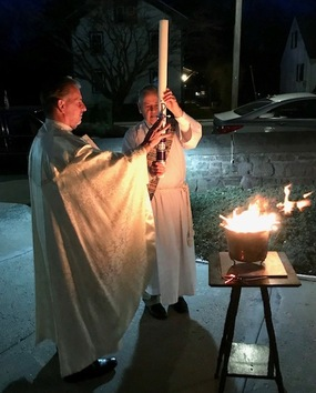 Easter Vigil blessing of the Easter Candle by Fr. John and Deacon Dana.