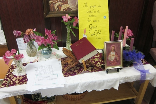 Prayertable arrayed with prophecy and flowers