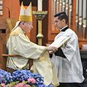 Bishop ordains 10 men to diaconate