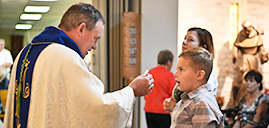 Bishop leads OLQP parishioners as they celebrate church's 70th anniversary