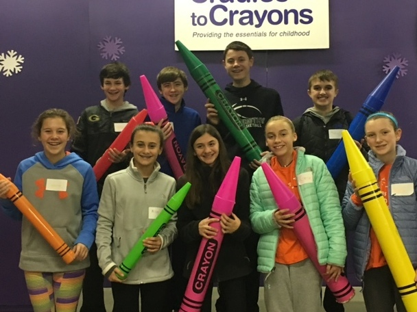St. Dorothy Community Service Corp volunteered at Cradles to Crayons.  They brought donations and packed 157 bundles of books.
