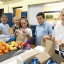 Eagles in Action: St. Joseph students make hundreds of lunches for those in need