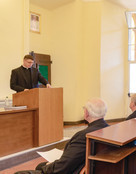 Father Connors defends doctoral dissertation