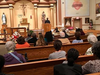 Catholics come together in faith, to celebrate African tradition