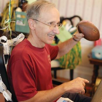 Lifelong fan, Father Ray Suriani, gifted with tickets to Green Bay Packers game