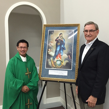 Knights of Columbus present Fr. Dat with Icon Blessed by Our Pope