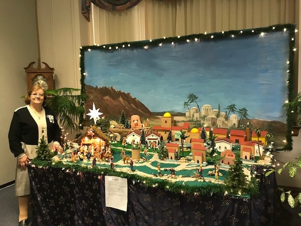 Sister Angela, one of our Catechists, and her beautiful Bethlehem village!