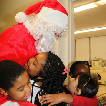 Santa celebrates Jesus' birthday at St. Stephen's School