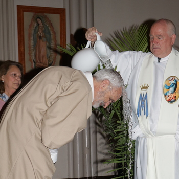 Fulfilling a dream at 67, man initiated into the Church