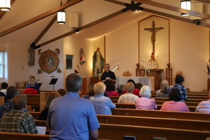 Father Rory Pitstick address pilgrims in Wilbur, Wash.