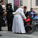 Pope Francis embraces child writer in a wheelchair